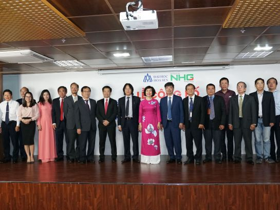 NHG board of directors, members in the new board of management, Professor, Dr. Mai Hong Quy and HSU lecturers taking photos in the ceremony.