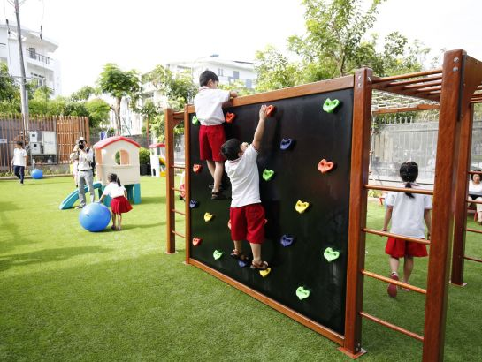 SNA elementary students play at outdoor playgrounds with colorful games