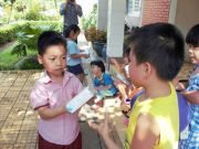 Tran Anh Minh, a pupil of SGA To Vinh Dien, was giving presents to his peers at Thu Duc Youth Village.