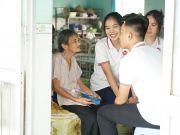 SNA students chatting with the elderly at Xuan Loc nursing home.